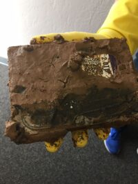 A hard drive covered in mud sent in for data recovery